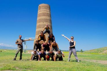 human pyramid in front of Burana Tower Kyrgyzstan group tour