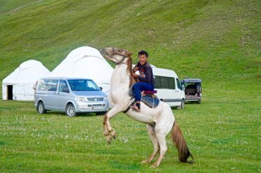 Brave boy on horse Kyrgyzstan travel
