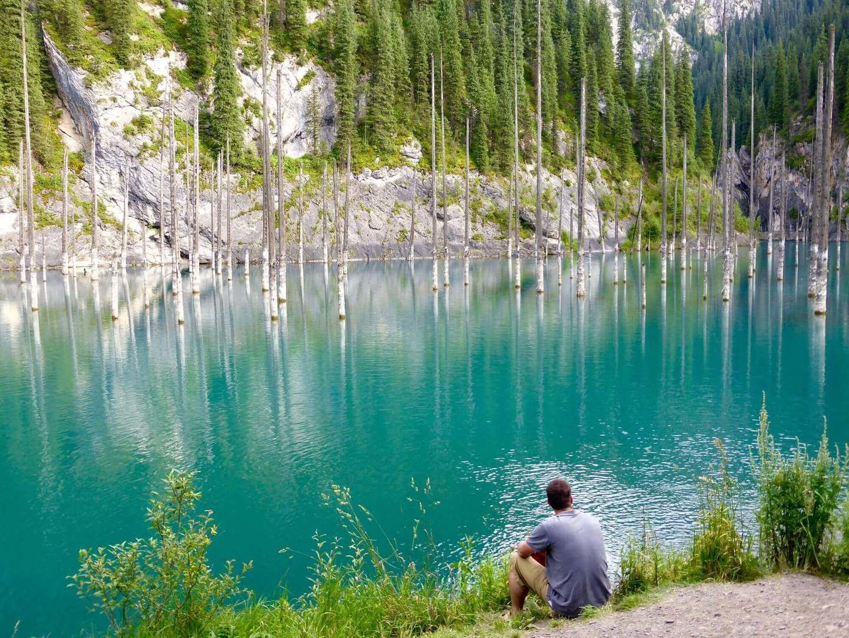Tourist at the Kaindy Lake, Kazakhstan travel