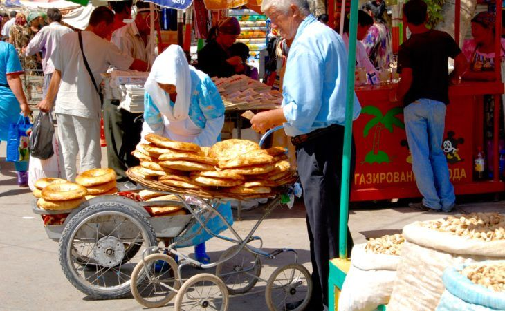 buying traditional bread during Central Asia Tour