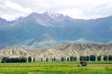 Transporting grass for winter Kyrgyzstan tour, central asia travel