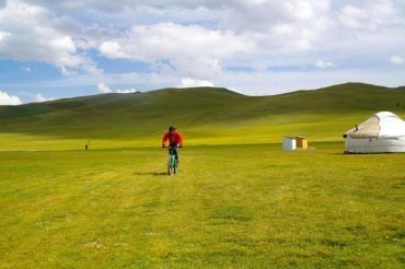 Biking in nature Kyrgyz pastures