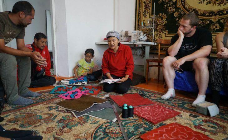 kyrgyz women explain how to make felt carpets