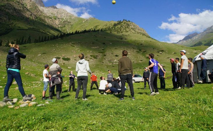 group of young friends playing nomad games in kyrgyzstan