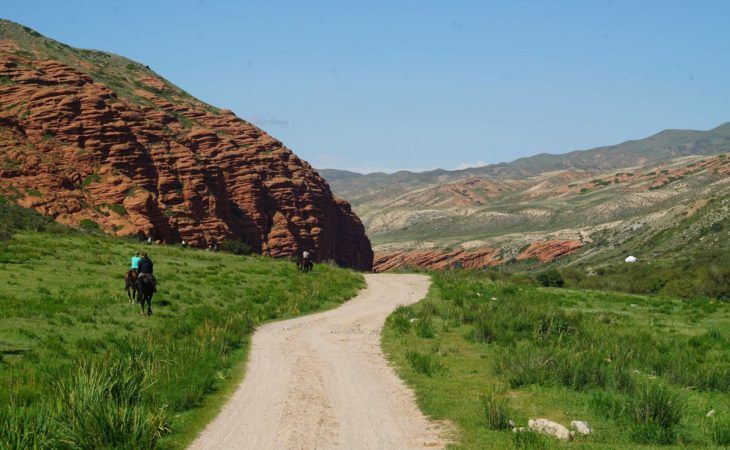 road going to horse riding during Kyrgyzstan tour