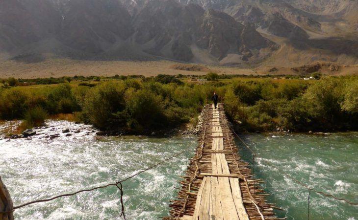 Pamir fragile bridge made of branches in Tajikistan Travel