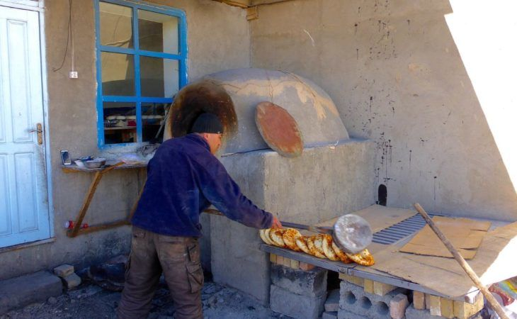 Baker in Murghab making local bread and food