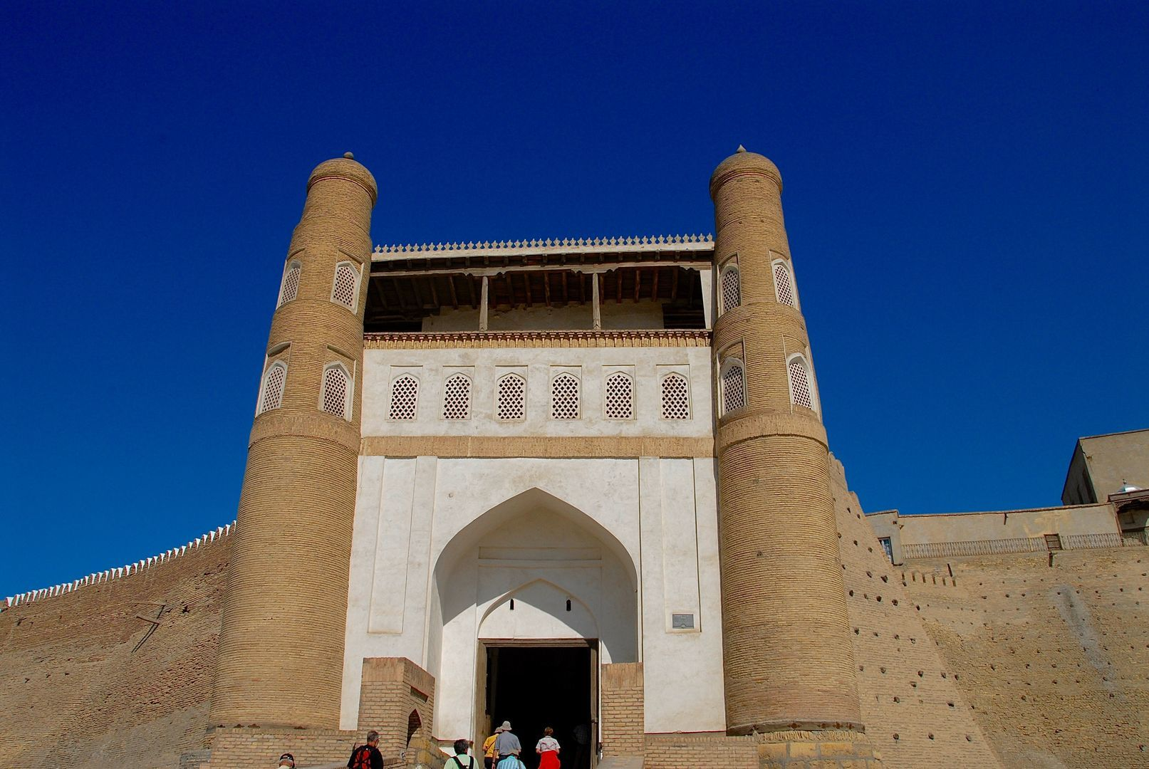 Bukhara Ark Fortress- huge entrance with two towers as visited in Uzbekistan Tour