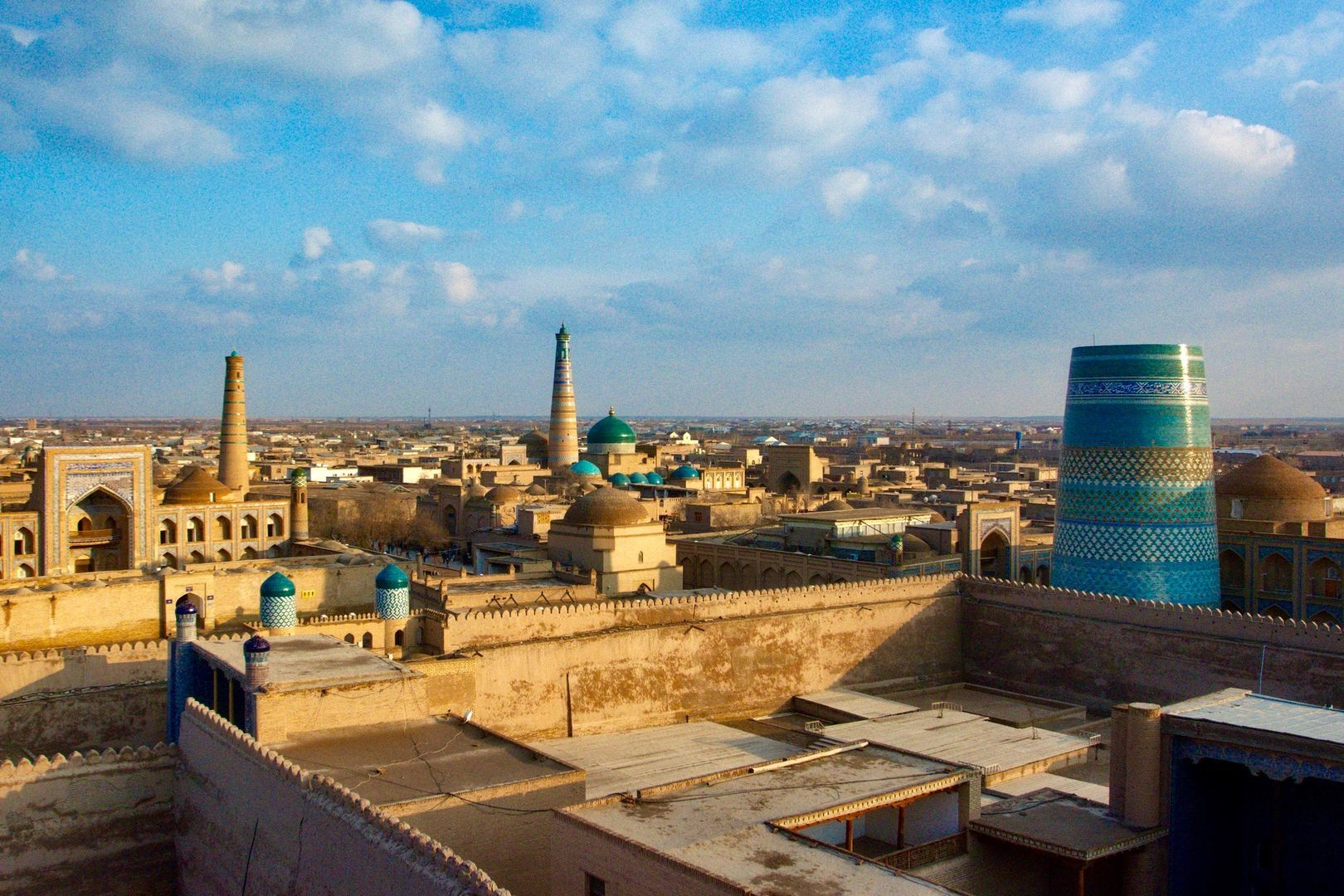 View of Khiva in evening sun light with blue minaret