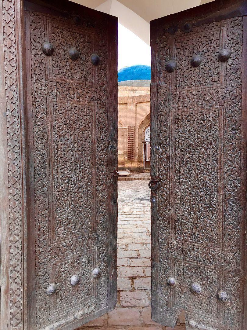 old wooden and beautifully carved door in Uzbekistan