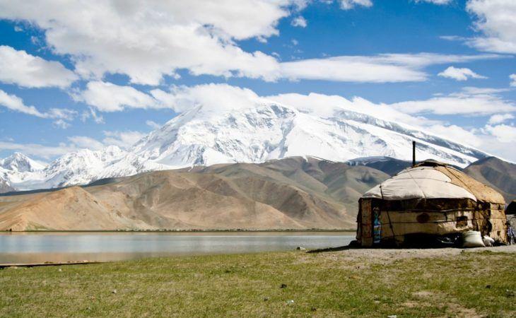 yurt standing in front of mountains on Kashgar Tour