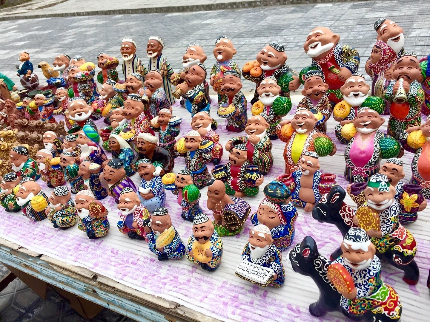 souvenirs of colorful Uzbek statues during Central Asia Tour