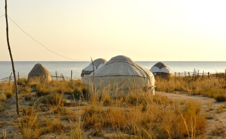 yurt camp in front of Issyk Kul lake on kyrgyzstan