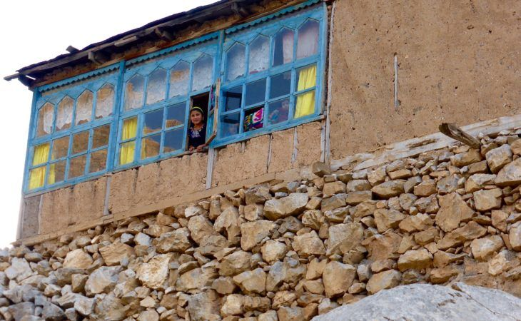girls looking out of the window in tajikistan fann mountains village