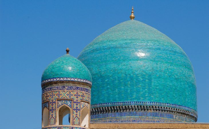 big and small blue dome of the building in Uzbekistan, silk road adventure