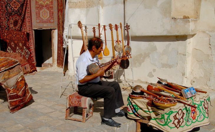 musician in Bukhara playing Uzbek music instrument