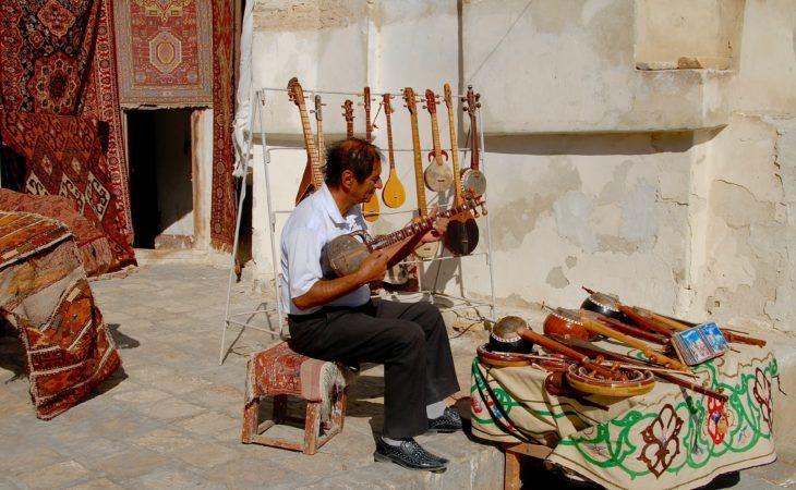 musician in Bukhara playing Uzbek music instrument