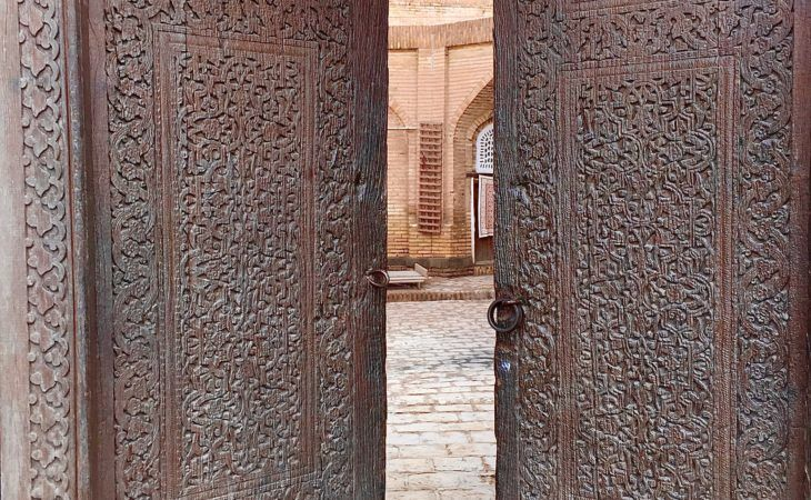 opening of ancient carved door in Khiva