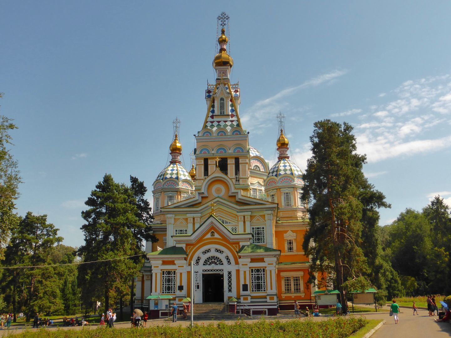 Zenkov wooden cathedral in Almaty with colorful full facade, city travel in Kazakhstan