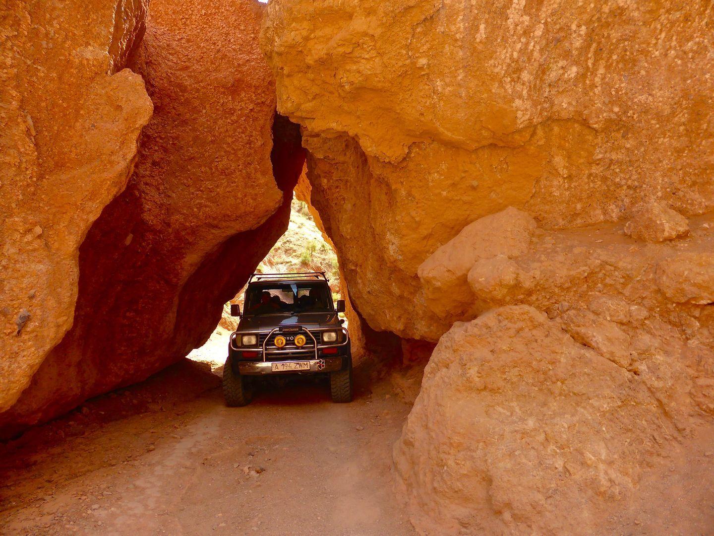 big car passing through the Charyn Canyon