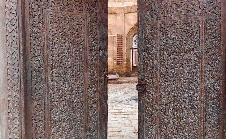 ornately decorated wooden door in Uzbekistan