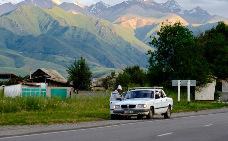 outskirts of Bishkek, men in Kalpak, getting out of Soviet car