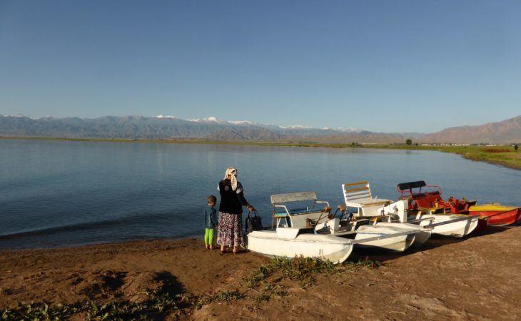 issyk kul lake Kyrgyz people walking at the shore