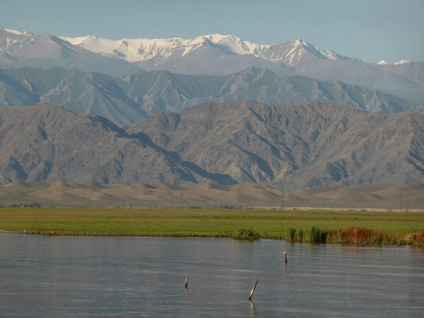 view of Tian Shan mountains and Issyk Kul, one of the Kyrgyzstan tourist spots