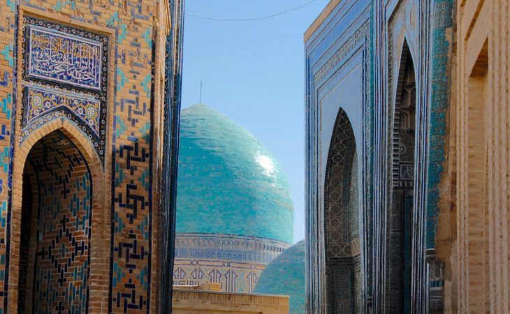 alley leading to the blue domes of tiurid architecture in Samarkand-uzbekistan-holidays
