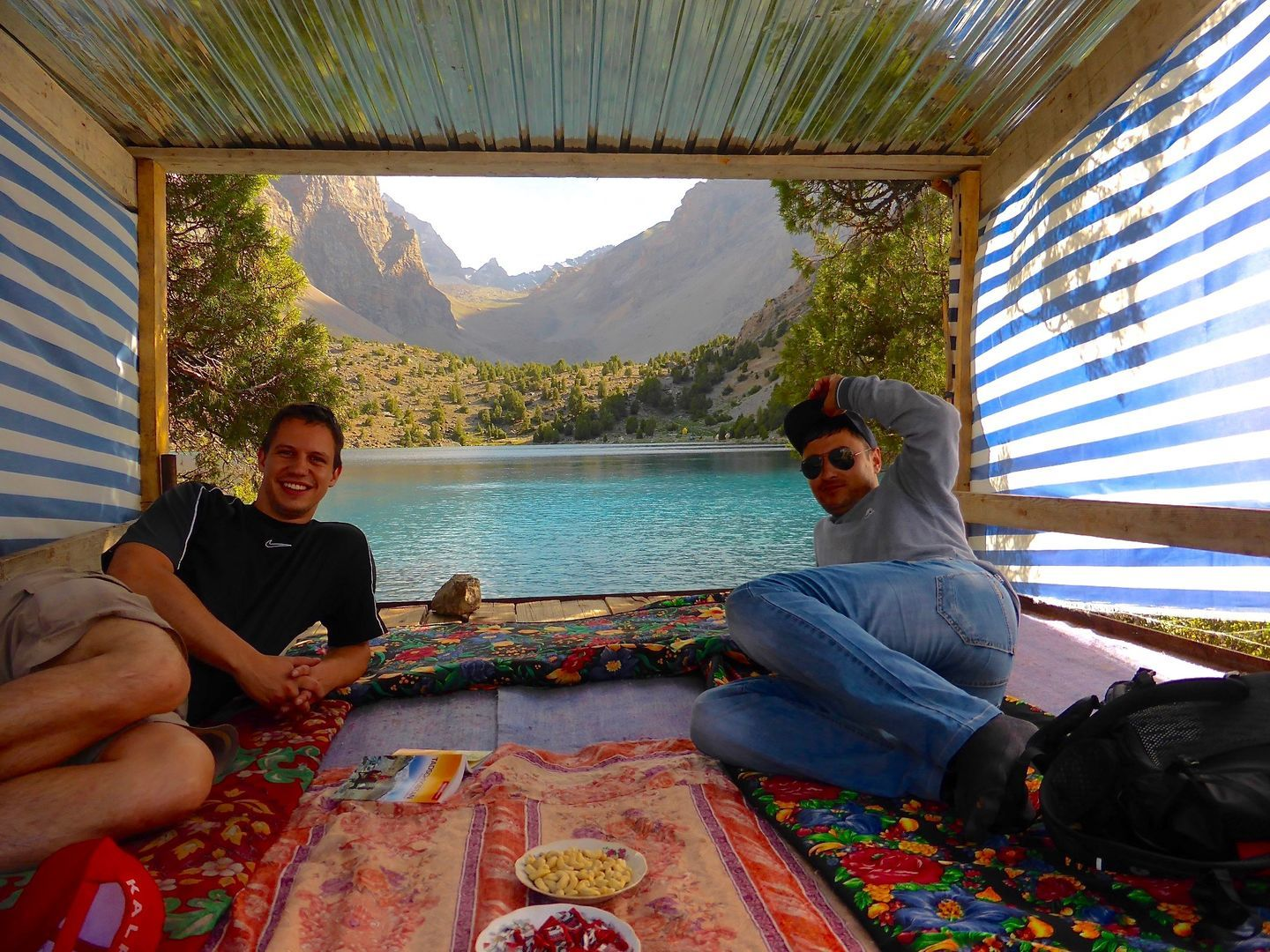 travelers dinner with nice view in Tajikistan, relaxing at the Fann Mountains Trekking Tour