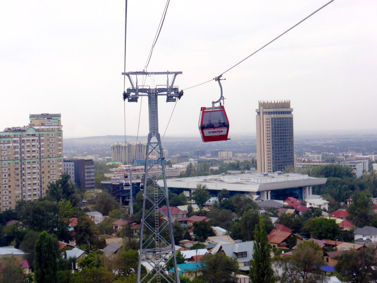 red funicular with Almaty city in the background, kazakhstan tour