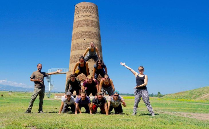 group tour photo in front of Burana Tower in Kyrgyzstan