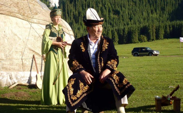 manaschi and kyrgyz traditional folklore concert in front of the yurt in kyrgyzstan