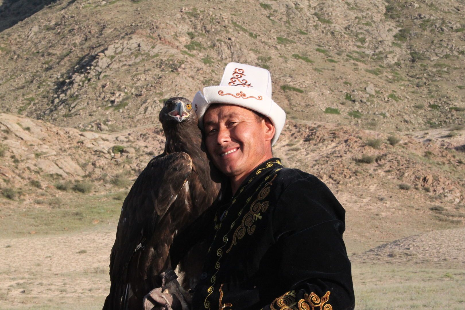 kyrgyz eagle hunter holding his eagle