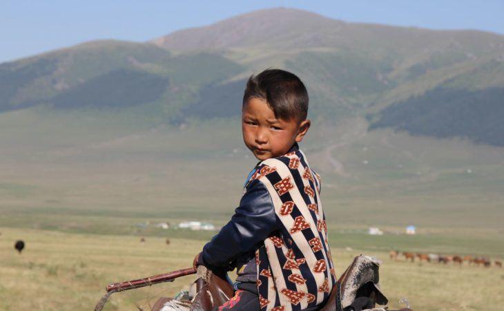 Kyrgyz boy sitting on a horse