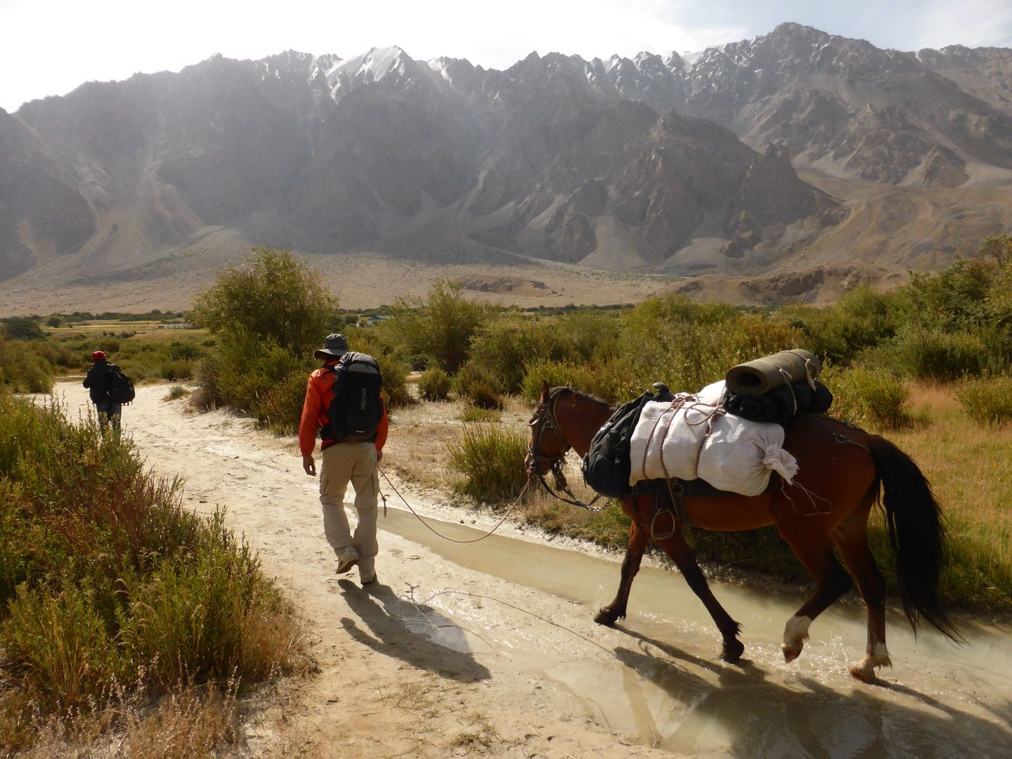 Horse and guide during trekking tour in Tajikistan