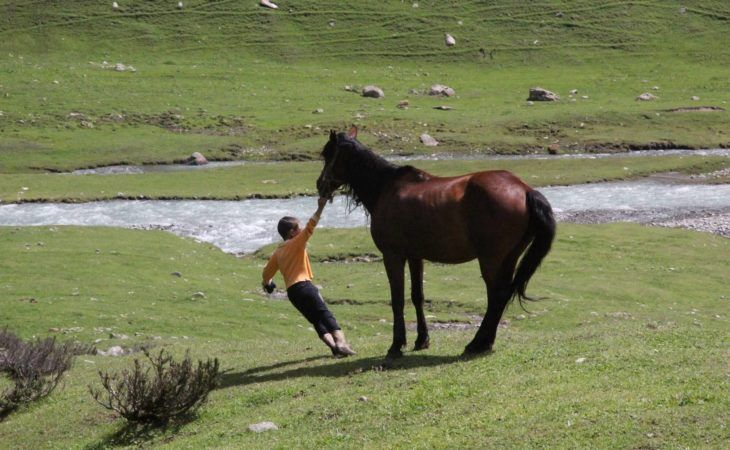 Shepherd boy with horse in Kyrgyzstan