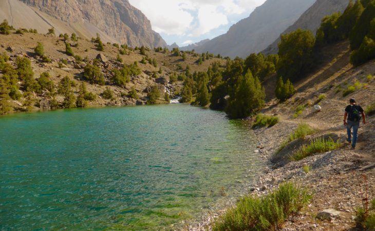 Hiking tourist in Fann Mountains near lakes of Tajikistan, Best of Central Asia Tour