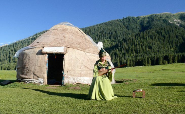 kyrgyz girl singing in front of the yurt