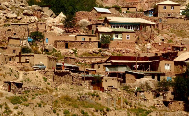Tajik village with mud houses on mountain slopes in Best of Central Asia Tour