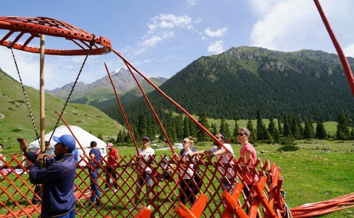 building the second element of the yurt in kyrgyzstan's mountains