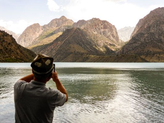 tajik man at iskanderkul lake-top 10 places to see in tajikistan