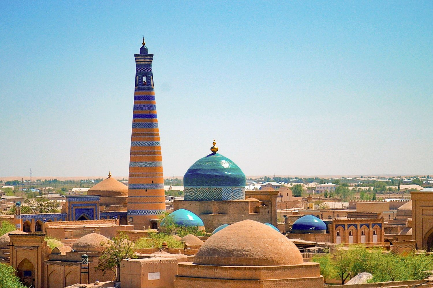 the highest minaret of Khiva rising above the city in Uzbekistan, Central Asia adventure