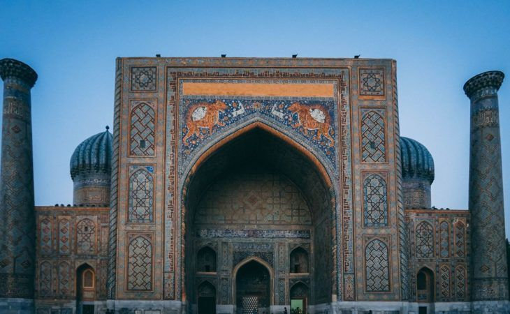Grand entrance of the Sher-Dor Madrasah in Samarkand, Uzbekistan