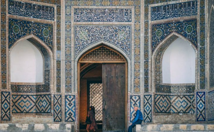 Uzbekistan Travel: Men in front of Bukhara mosque