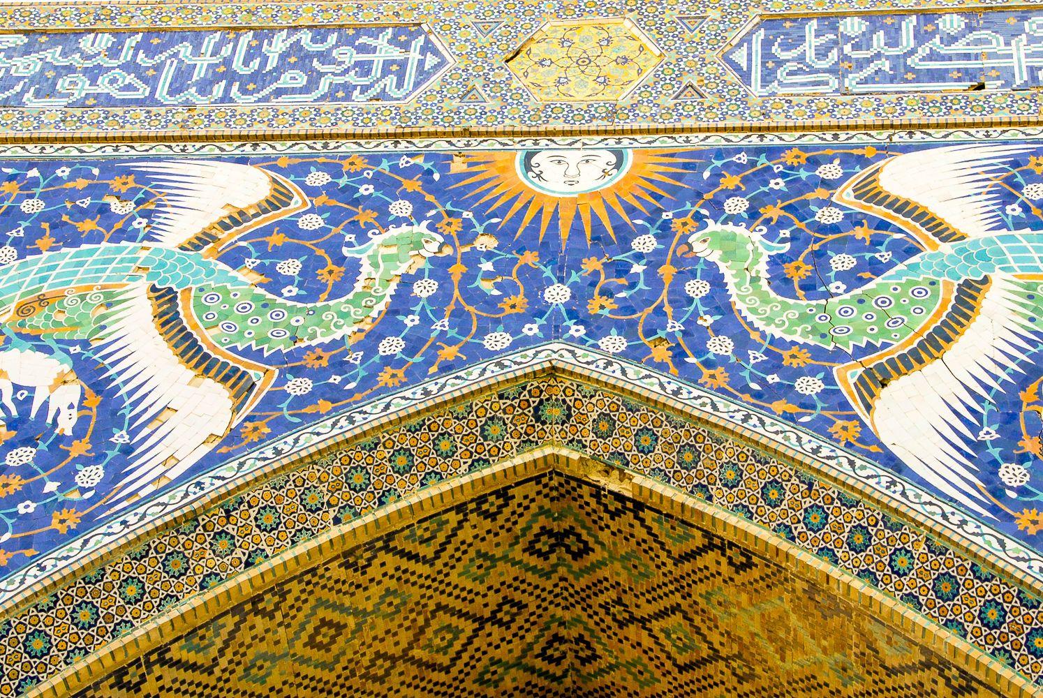 Madrasah with bird decoration mosaic in Bukhara, uzbekistan tourism