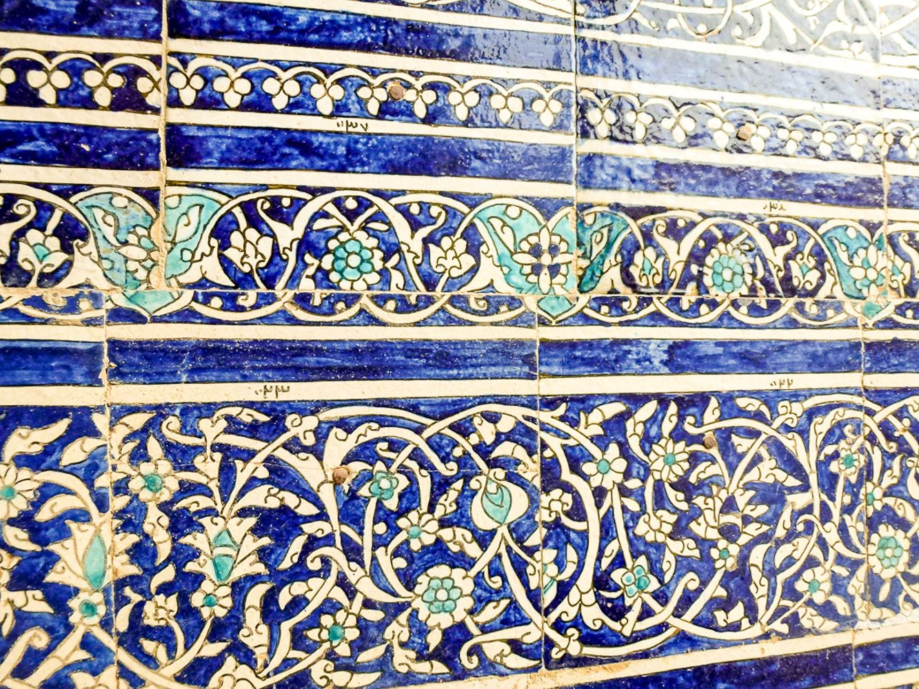 decortation detail on blue tiles of khiva palace in uzbekistan travel