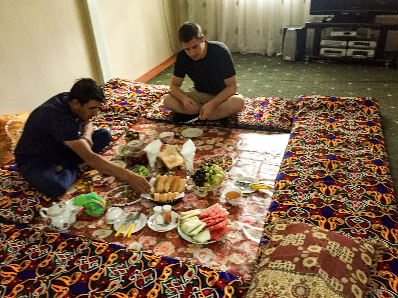 Tourists eating at dastarkhan in Central Asia