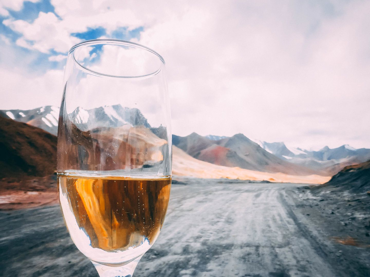 Central Asia landscape, glass of champagne