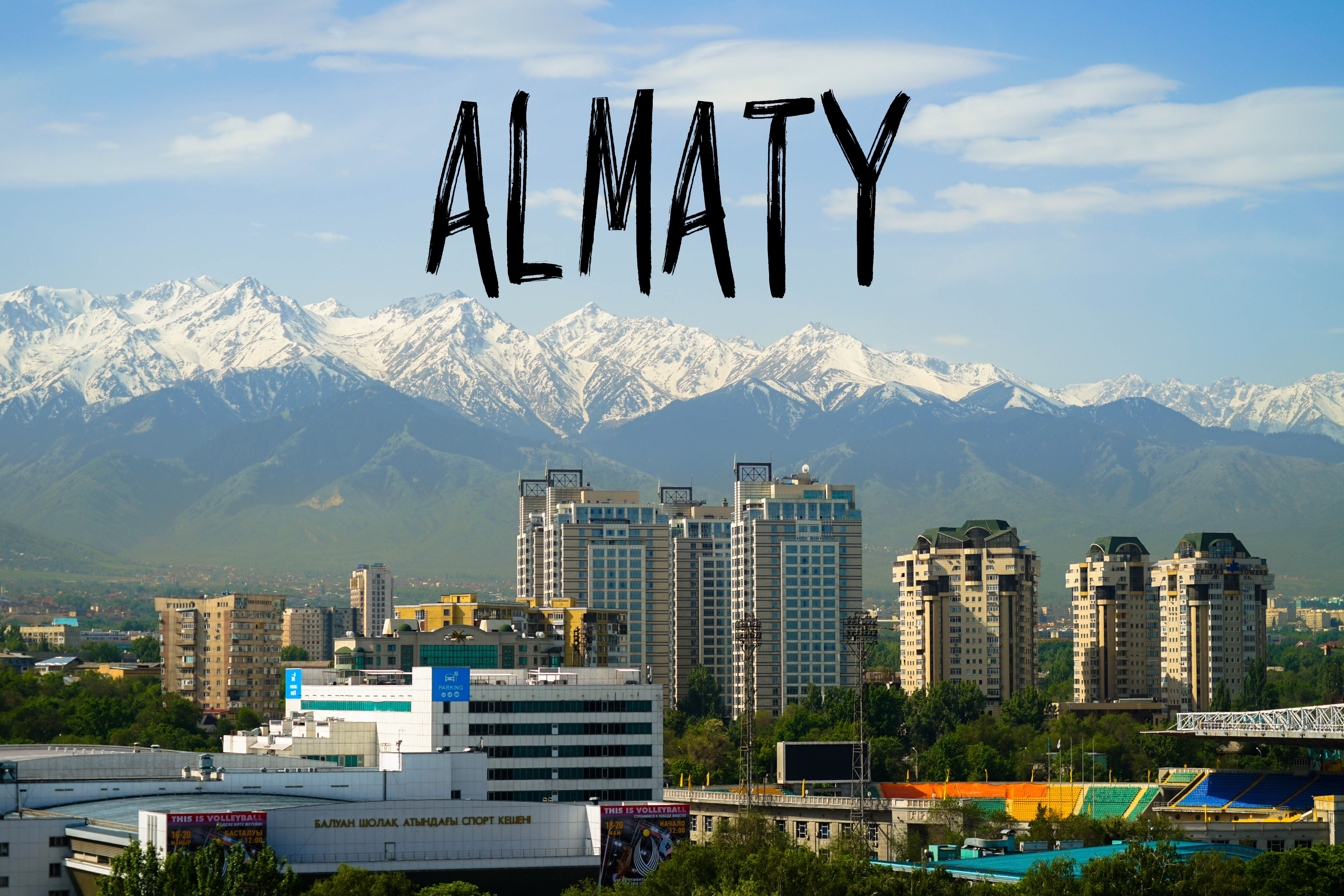 Almaty city view with text overlay Almaty